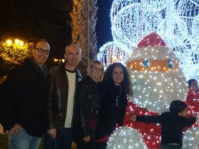 Photo of my friends and I with the illuminated Santa