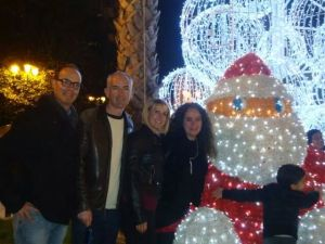 Photo of my friends and I with the illuminated Santa