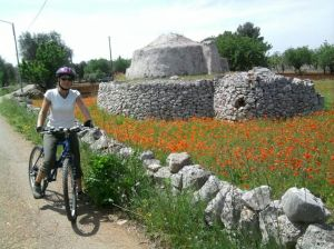 Cyclists, Trullo and poppies.