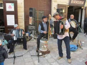 Traditional Folk band playing in the Piazza