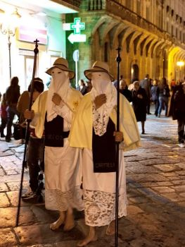 Hooded pilgrims performing a Christian ritual