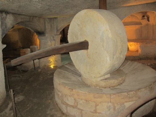 Antique olive oil press