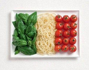 Italian flag made from basil, spaghetti and tomatoes