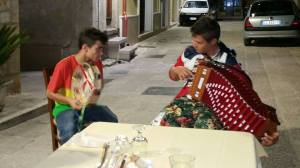 Local lads playing traditional Pizzica music.Local lads playing traditional Pizzica music.
