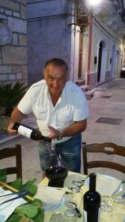 Giuseppe Schiena pouring his wine, Angioino.