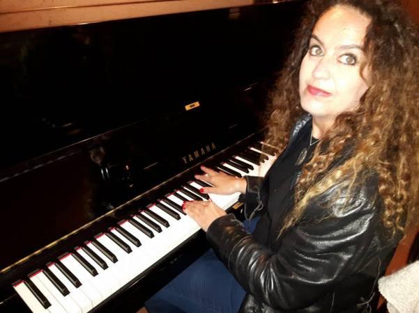 My friend hitting a few notes on the grand piano at Giudamino