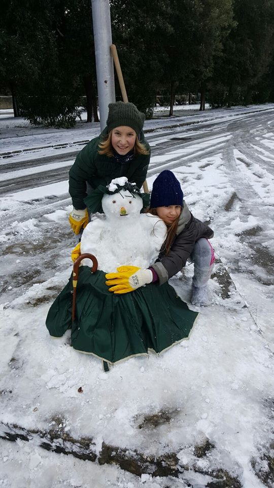 Kids loving the snowman they built