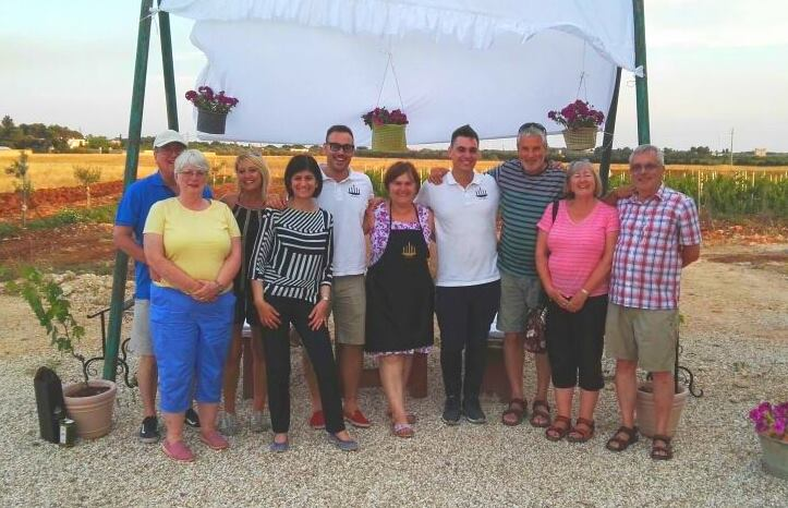 Group photo with vineyard owners, guests and Puglian Pleasures